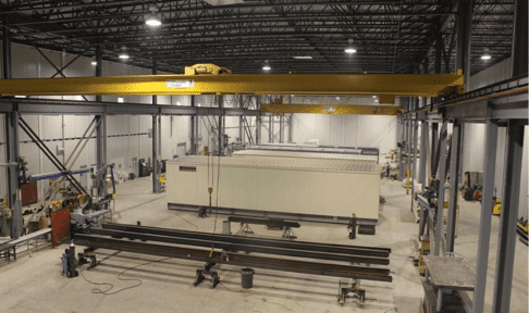 Assembly Line Process of Enclosure to work cells using 5 and 30 Ton Bridge Cranes